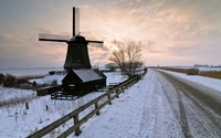 Old windmill on a snowy field wallpaper 2560x1440 jpg