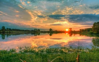 Orange sunset reflecting in the lake wallpaper