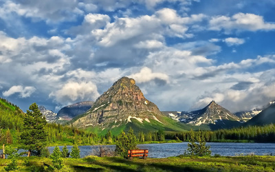 Peaks rising towards the clouds in Glacier National Park wallpaper