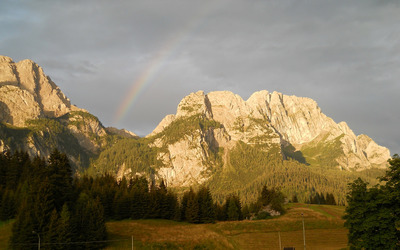 Rainbow over the rocky mountains wallpaper