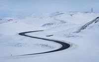 Road through the snowy hills wallpaper 1920x1200 jpg