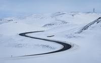 Road through the snowy hills wallpaper 1920x1200 jpg