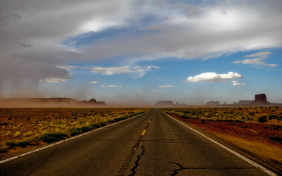Road towards a storm in the canyon wallpaper