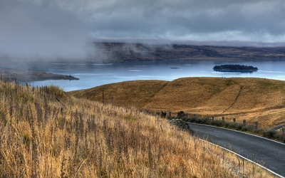 Road towards the foggy lake Wallpaper