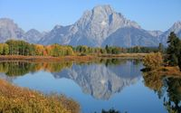 Rocky mountain behind the forest reflected into the lake wallpaper 2560x1600 jpg