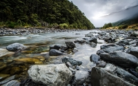 Rocky mountain river on a clouded day wallpaper 2560x1600 jpg