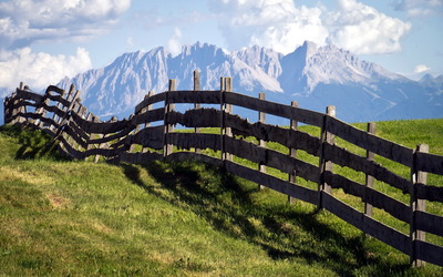 Rocky mountains behind the fence wallpaper
