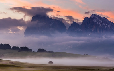 Rocky mountains hiding in the fog Wallpaper