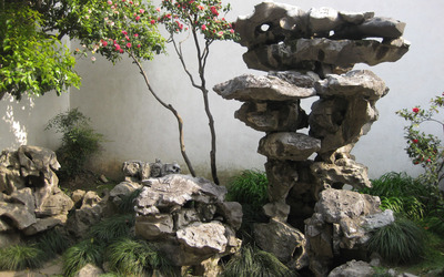 Rocky sculpture in the garden wallpaper