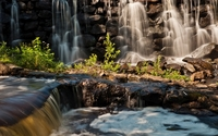 Rocky waterfall reaching to the whriling river wallpaper 1920x1200 jpg