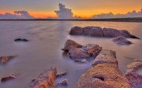 Rusty rocks in the water guarding the beautiful sunset light wallpaper 2880x1800 jpg