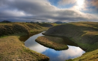 Small island splitting the calm river wallpaper 2560x1600 jpg