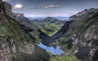Small lake splitting the mountains wallpaper 1920x1200 jpg
