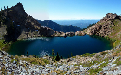 Small lake surrounded by the mountains Wallpaper