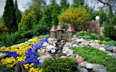 Small stone castle in the garden wallpaper