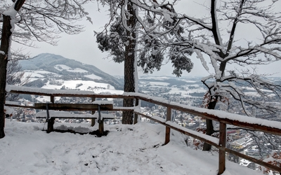 Snowy bench on the hill wallpaper