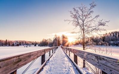 Snowy bridge to the sun Wallpaper