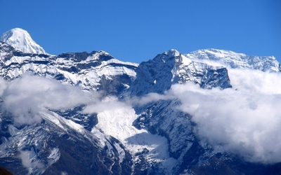 Snowy Himalayas higher than clouds wallpaper