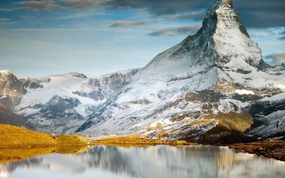 Snowy Matterhorn reflecting in the lake wallpaper