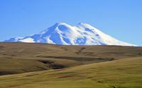 Snowy mountain peak by the spring hills wallpaper 3840x2160 jpg