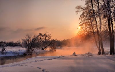 Steam rising from the river by the frozen nature wallpaper