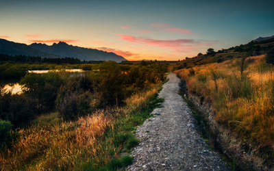 Stone path on the river side towards the sunset wallpaper