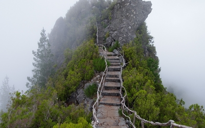 Stone stairs to the foggy rocky peak wallpaper