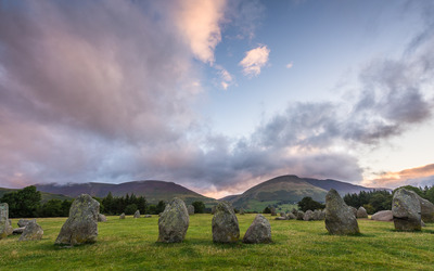 Stones rising from the grass wallpaper