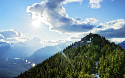 Sun ray over the forest mountain wallpaper