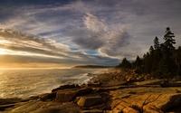 Sun rising to warm up the rocks on the ocean shore wallpaper 1920x1200 jpg