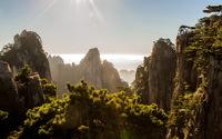 Sun shining above the forest cliffs wallpaper 2560x1600 jpg