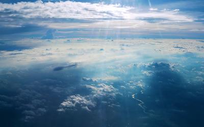 Sunlit clouds wallpaper