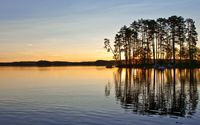 Sunset hiding behind the tall trees on the lake side wallpaper 2560x1600 jpg