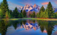Sunset light reflecting on the snowy peaks of Grand Teton mounta wallpaper 2560x1600 jpg