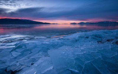 Sunset over frozen lake wallpaper