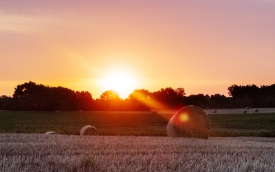Sunset over the bales wallpaper