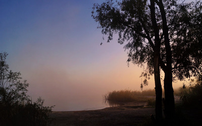 Sunset over the foggy lake wallpaper
