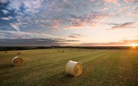 Sunset over the hay bales wallpaper 2560x1600 jpg
