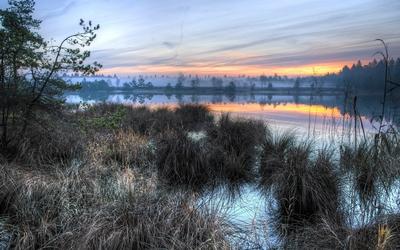 Sunset over the misty lake wallpaper