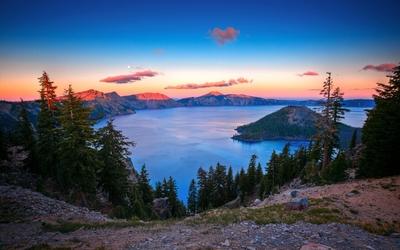 Sunset over the mountain peaks wallpaper