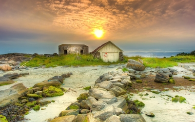 Sunset over the old huts wallpaper