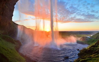 Tall waterfall in the sunset Wallpaper