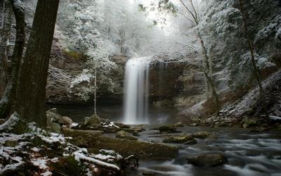Waterfall in winter forest wallpaper