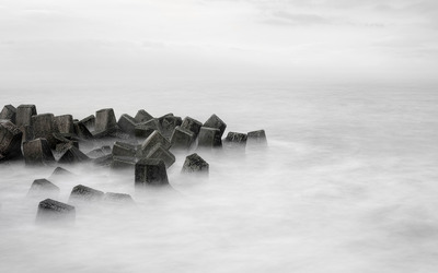 Waves over the breakwater wallpaper