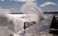 Waves splashing on the stone pier [2] wallpaper 2560x1600 jpg