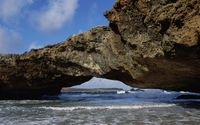 Waves under the rocky arch wallpaper 1920x1080 jpg