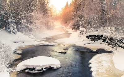 Winter river flowing towards the sunset wallpaper