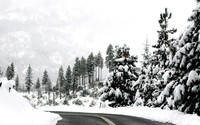Winter road through the mountains wallpaper 1920x1200 jpg