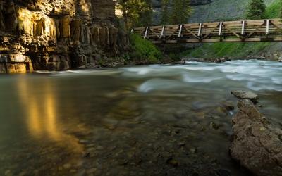 Wooden bridge across the river wallpaper