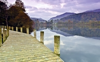 Wooden pier on the lake by the beautiful autumn forest wallpaper 2560x1600 jpg